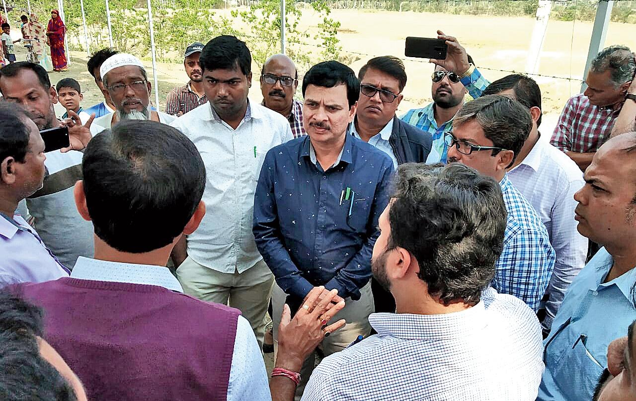 Flipkart officials speak to villagers on Tuesday.