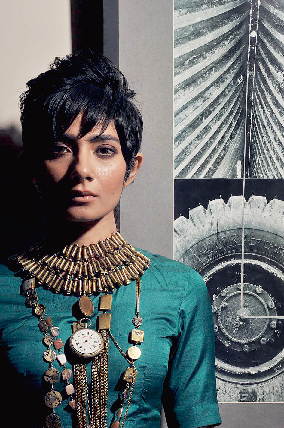"""Narayan had only Sneha in mind for this bold frame. His idea: slip on a solid-coloured blouse and deck it up. """"I have broken the identity of the jewellery here. I have used earrings too on the sap green blouse. Who said you need to wear jewellery like jewellery? You can use it as a button too. I think it is important to break boundaries,"""" said Narayan as he slipped on five or six brass and stone neckpieces on Sneha. Add three to four earrings to that mix. The result? A dramatic evening look"""