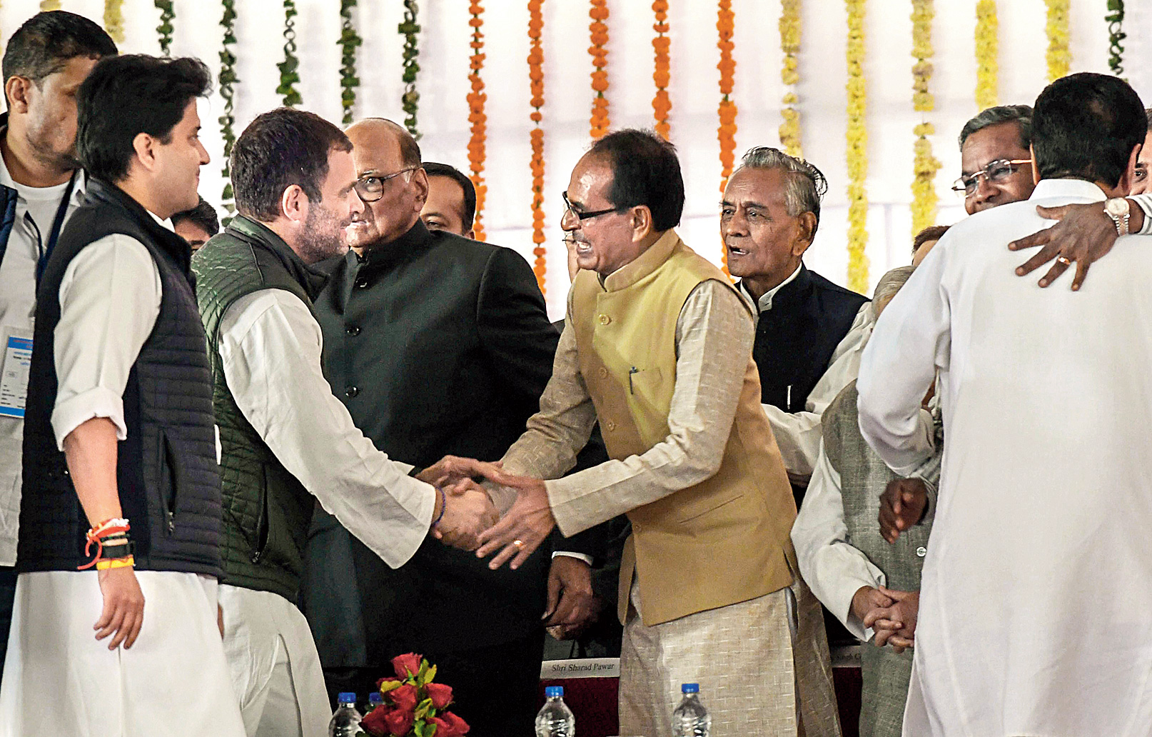 Congress president Rahul Gandhi shakes hands with BJP leader and former Madhya Pradesh chief minister Shivraj Singh Chouhan in Bhopal on Monday.