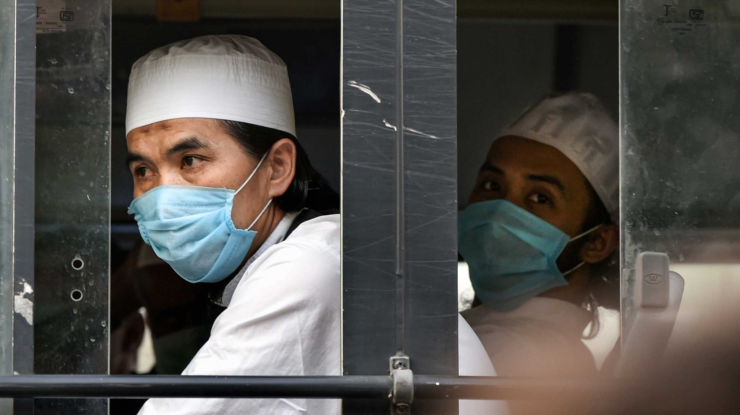 Members of the Tablighi Jamaat leave from LNJP hospital and head towards the quarantine centre in New Delhi on Tuesday.