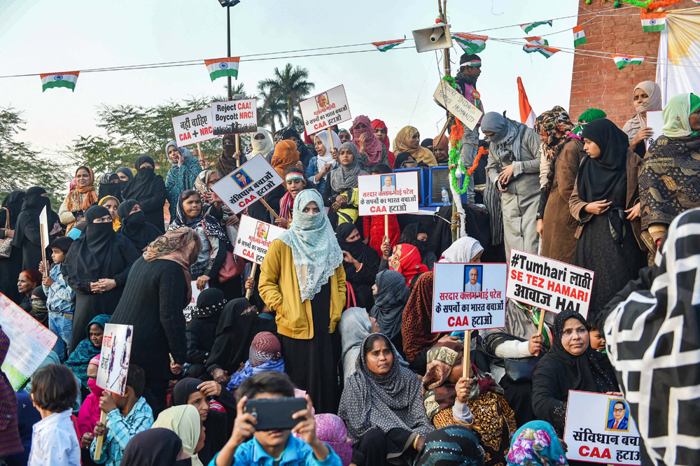 Protesters near the Ghanta Ghar in Lucknow on Monday.