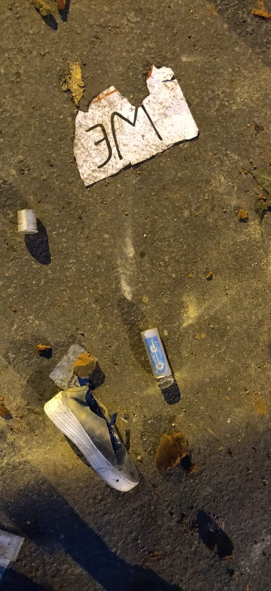 A tear gas shell is seen on the ground between a torn placard and a lost shoe, during a protest by Jamia Millia Islamia University students against the Citizenship Act , in New Delhi, Friday, December 13, 2109.