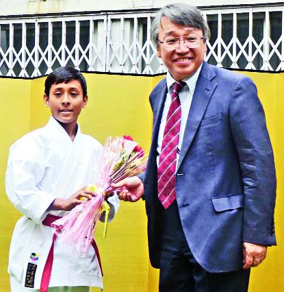 Consul general of Japan Masayuki Taga felicitates Amiyo Sundar Biswas at his residence on Tuesday.