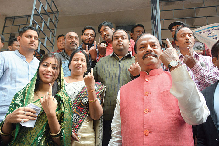 Family Vote: Raghubar Das, his son Lalit, wife Rukmini and daughter-in-law Purnima (left) show their inked fingers in Jamshedpur on Saturday.