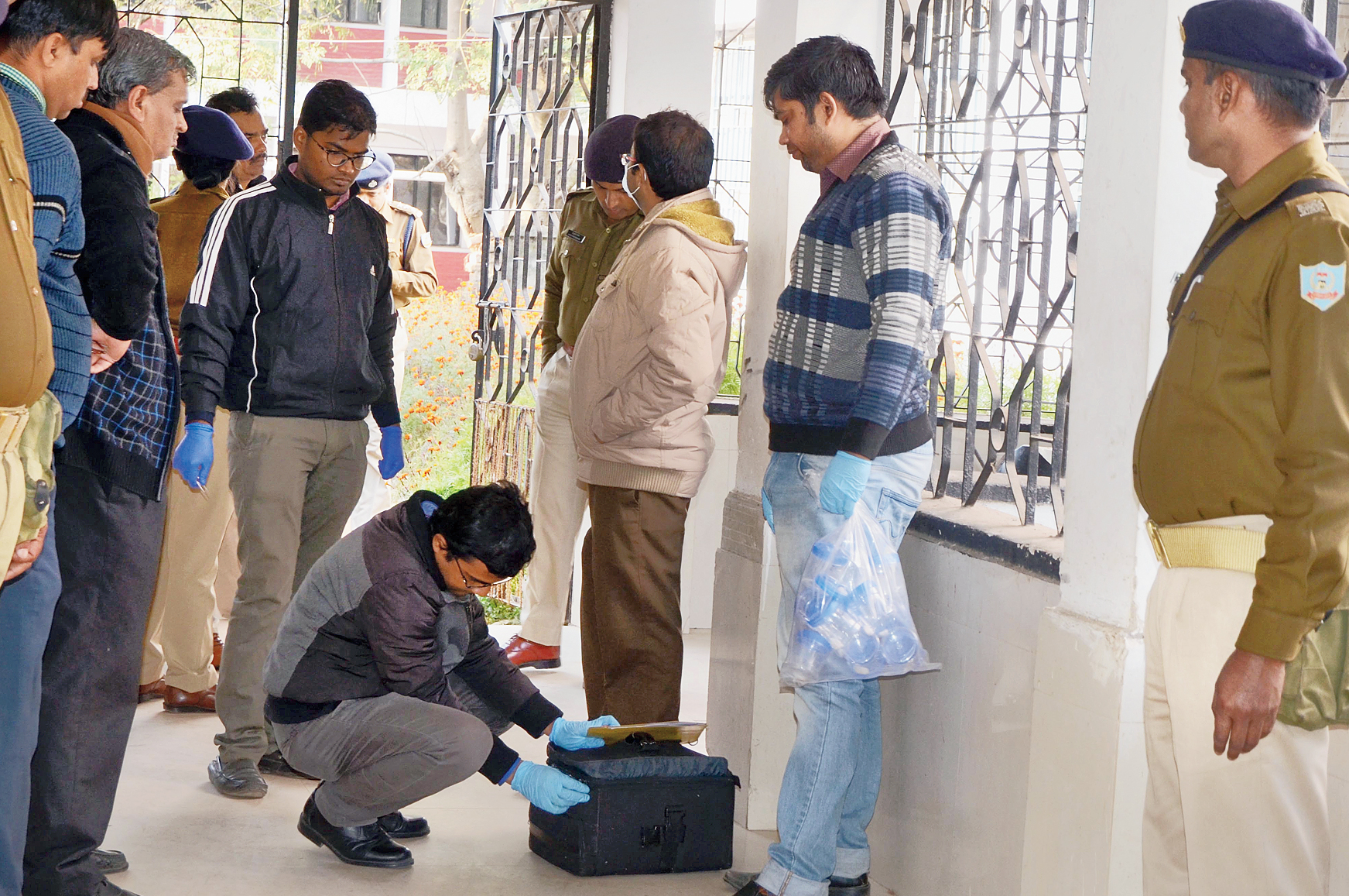 Clue hunt: Forensic experts collect evidence from the post-mortem department of RIMS in Ranchi on Friday in connection with Atyendra Mishra's death.