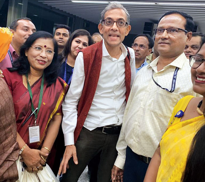 Abhijit Vinayak Banerjee with airport director Kaushik Bhattacharya and other officials on his arrival in Calcutta on Tuesday evening.