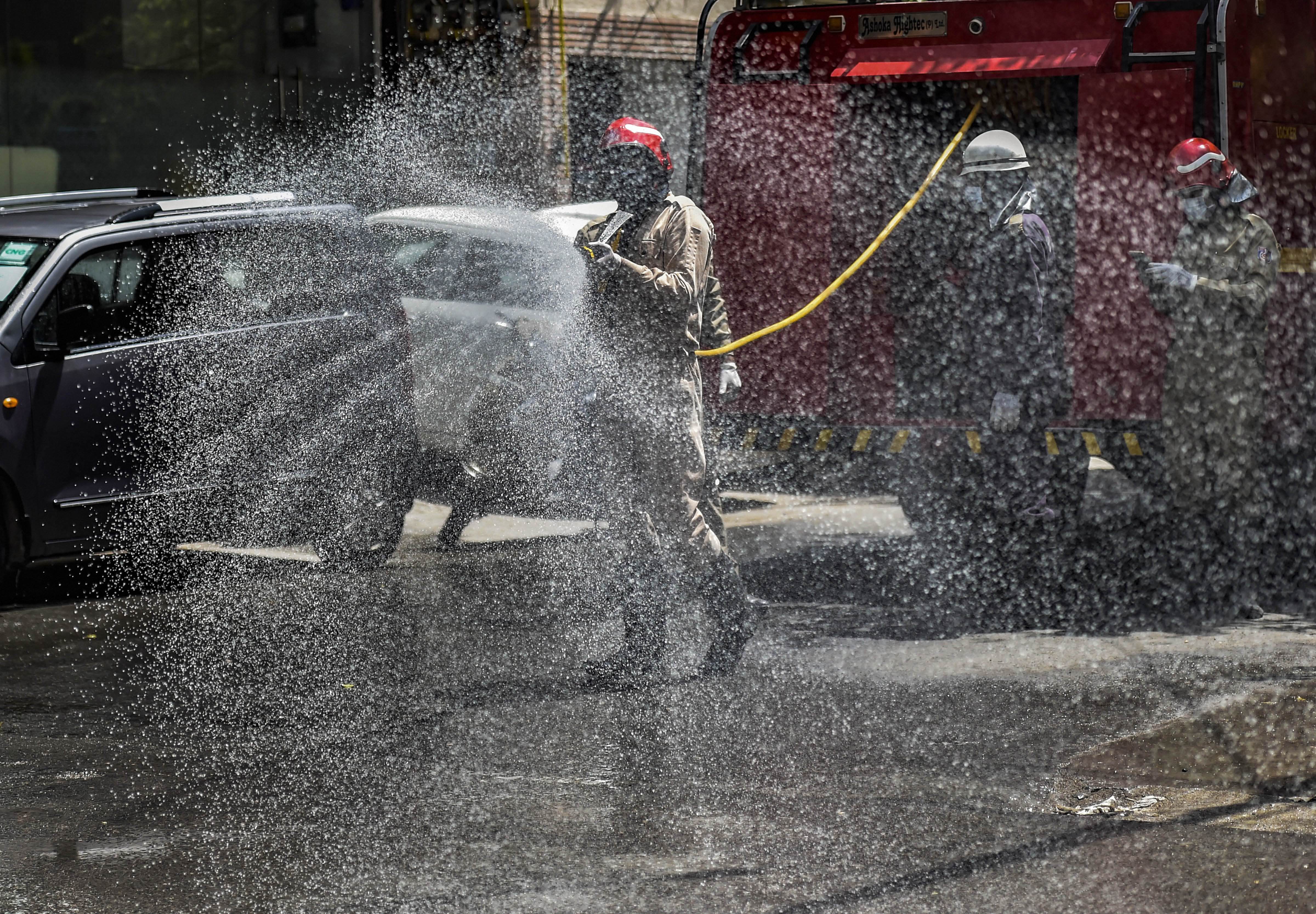 Firefighters spray disinfectants at Bhogal during the nationwide lockdown to curb the spread of coronavirus, in New Delhi, Thursday, April 9, 2020