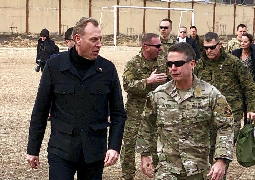 Pat Shanahan (left) arrives in Kabul on Monday morning.