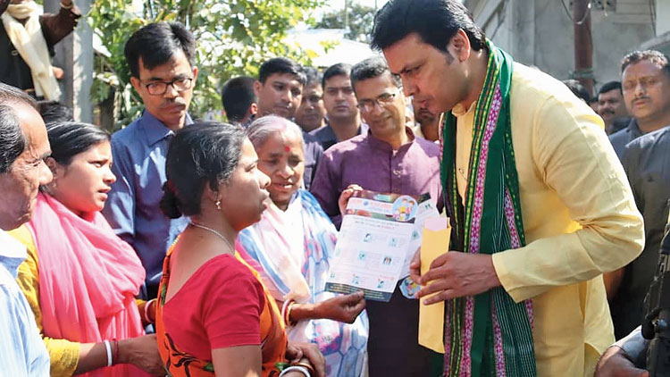 Tripura chief minister Biplab Kumar Deb distributes leaflets among the people to create awareness against coronavirus on Tuesday