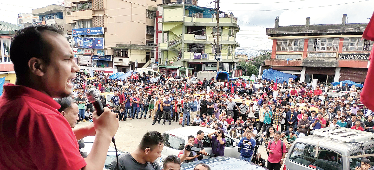 Confederation of Meghalaya Social Organisations chairman Robertjune Kharjahrin addresses the public meeting in Shillong on Tuesday.