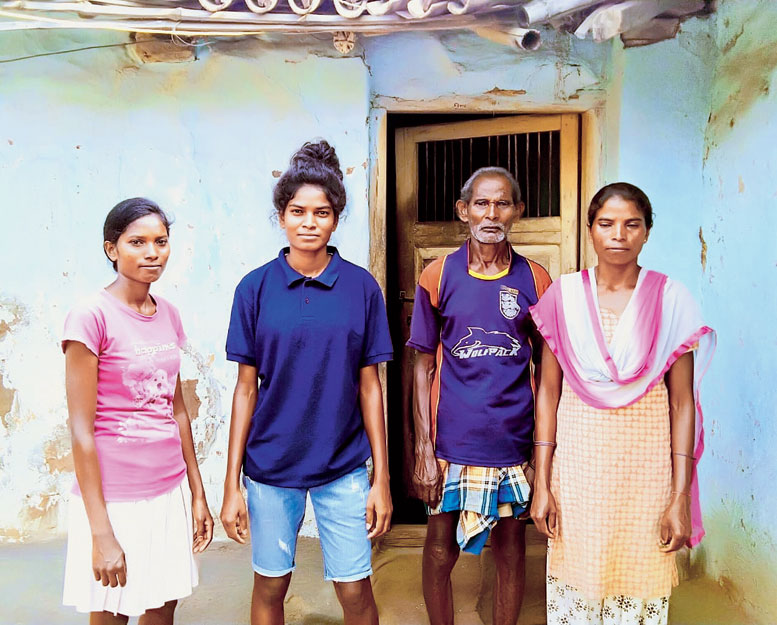 Purnima Kumari (in blue T-shirt) with her sisters and father at her house in Simdega.
