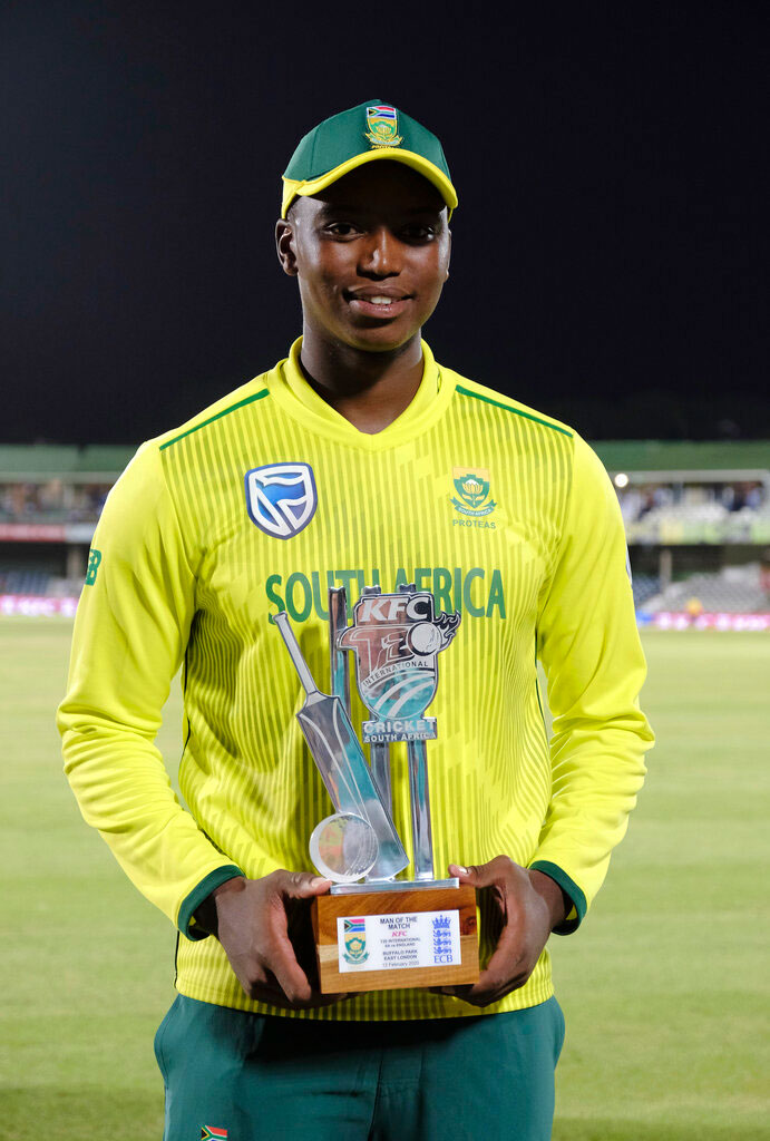 Lungi Ngidi of South Africa holds the trophy as man of the match, during the T20 cricket match between South Africa and England in East London on Wednesday