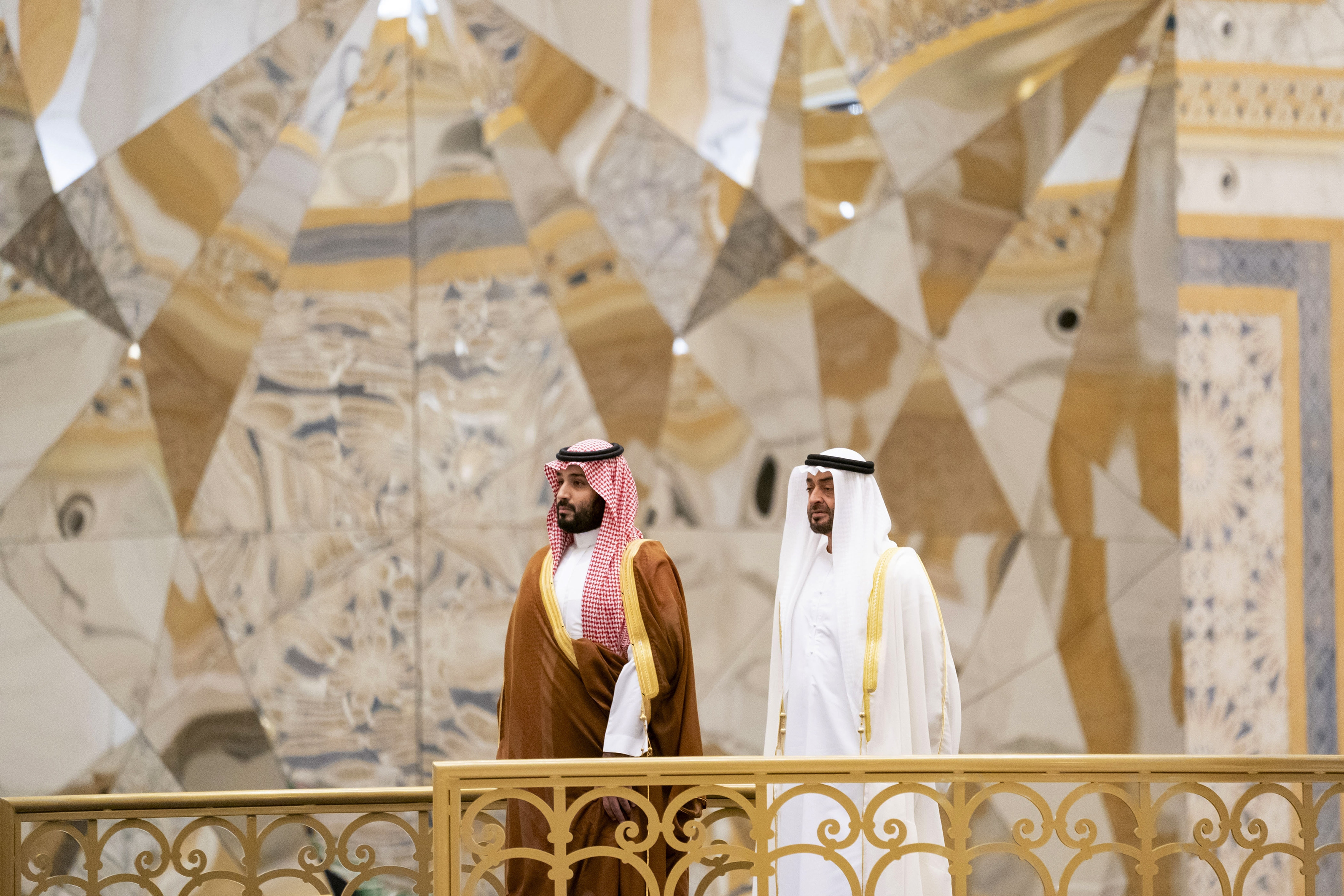 In this photo released by Ministry of Presidential Affairs, Prince Mohammed bin Salman, attends a ceremony with Prince Mohammed bin Zayed Al Nahyan at Qasr Al Watan in Abu Dhabi, United Arab Emirates on Wednesday, November 27, 2019,