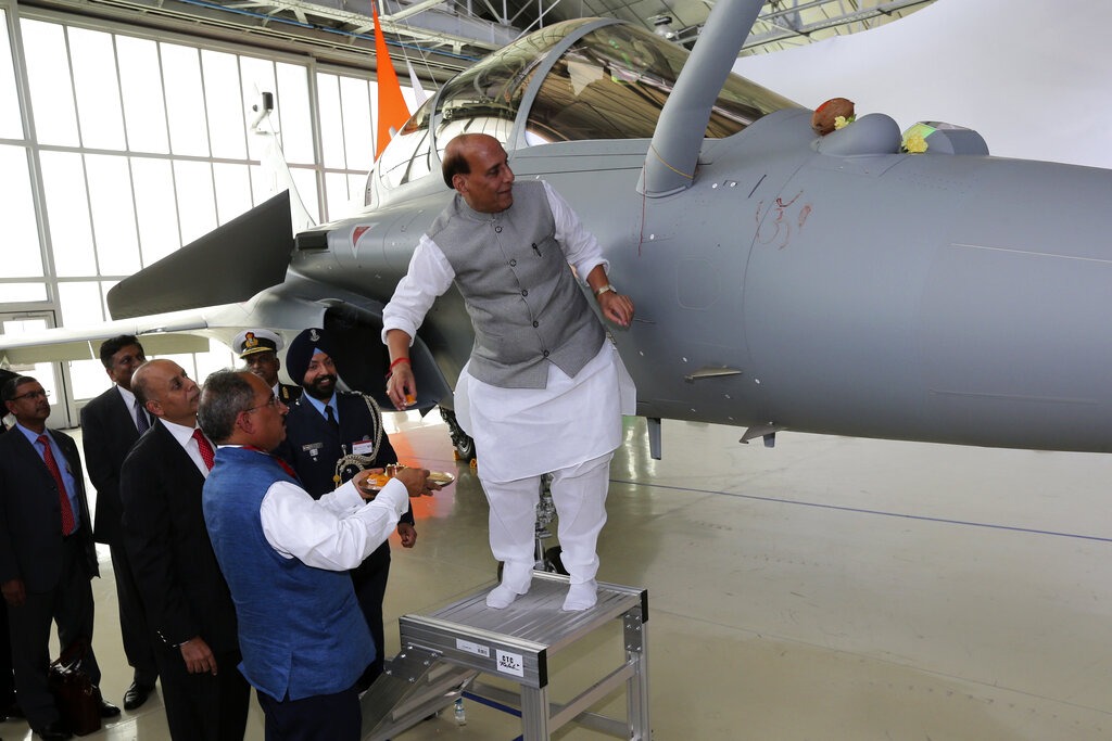 Defense Minister Rajnath Singh has a ritual gesture onto a Rafale jet fighter during an handover cermony at the Dassault Aviation plant in Merignac, near Bordeaux, southwestern France.