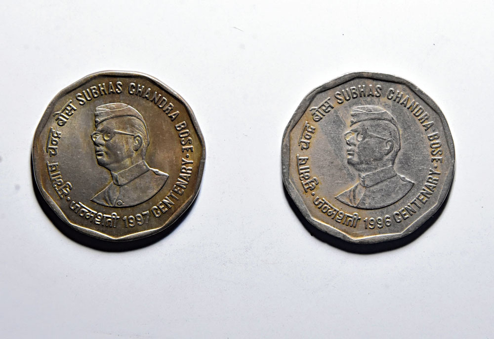 Spot the difference: The Rs 2 coin released by the government on Netaji's birth centenary in 1997 and another released by mistake a year ahead.