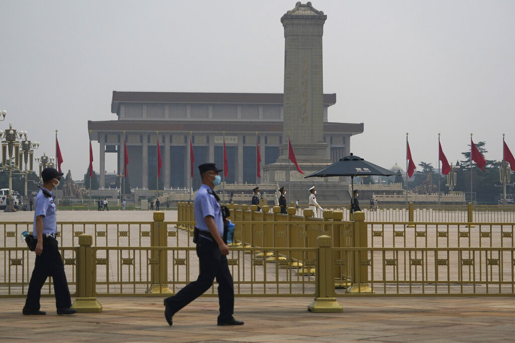 Police guard at the Tiananmen Square ahead of the opening of the third plenary session of the 13th National Committee of the Chinese People's Political Consultative Conference (CPPCC) in Beijing, Thursday, May 21, 2020.