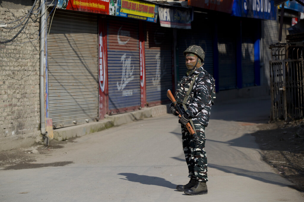 A paramilitary soldier stands guard outside a closed market during a strike in Srinagar on Thursday.