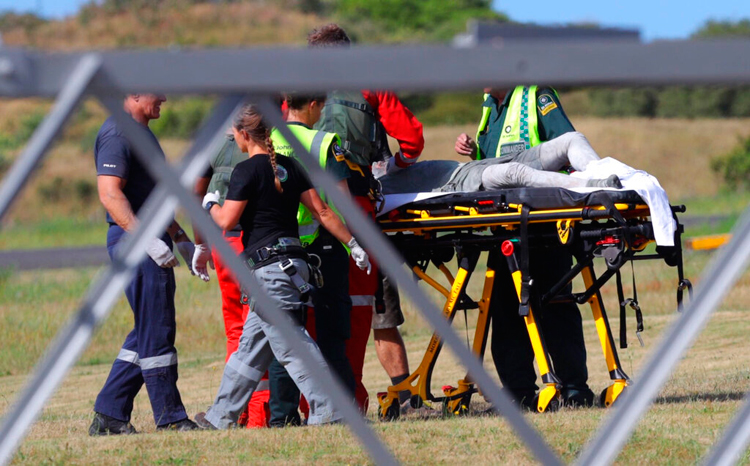 An injured person is given medical help at the Whakatane Airfield after the volcanic eruption on December 9 on White Island, New Zealand