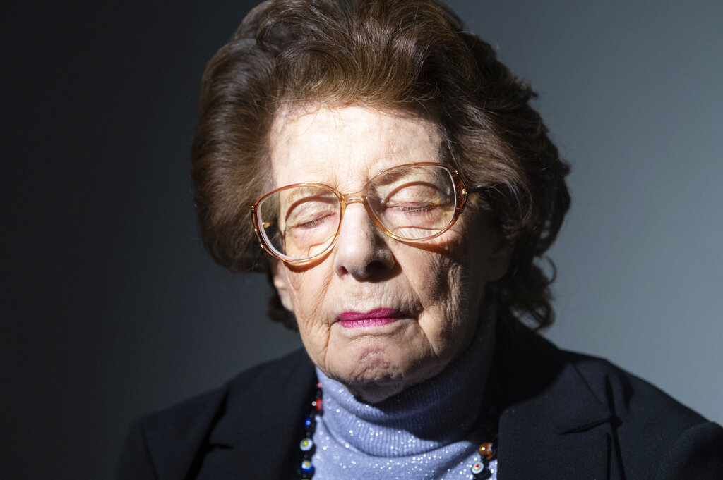 Auschwitz survivor Agi Geva poses for a photo at the United States Holocaust Memorial Museum in Washington