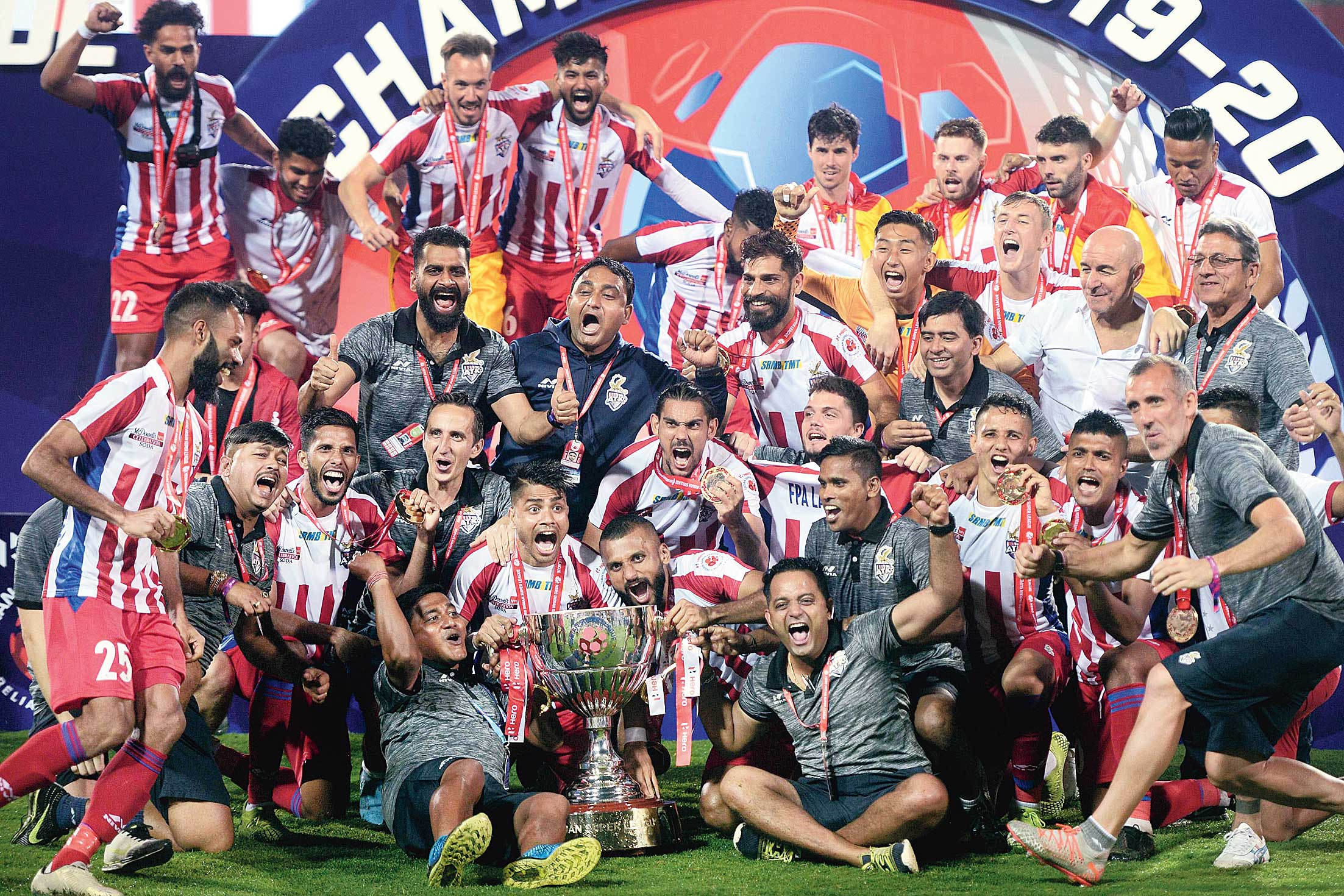 ATK players and support staff celebrate after winning the ISL title in Margao on Saturday.