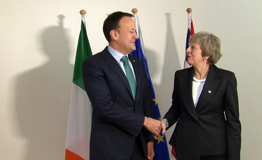 In this framegrab taken from Sky News on Thursday, Theresa May shakes hands with Irish Prime Minister Leo Varadkar in Brussels.