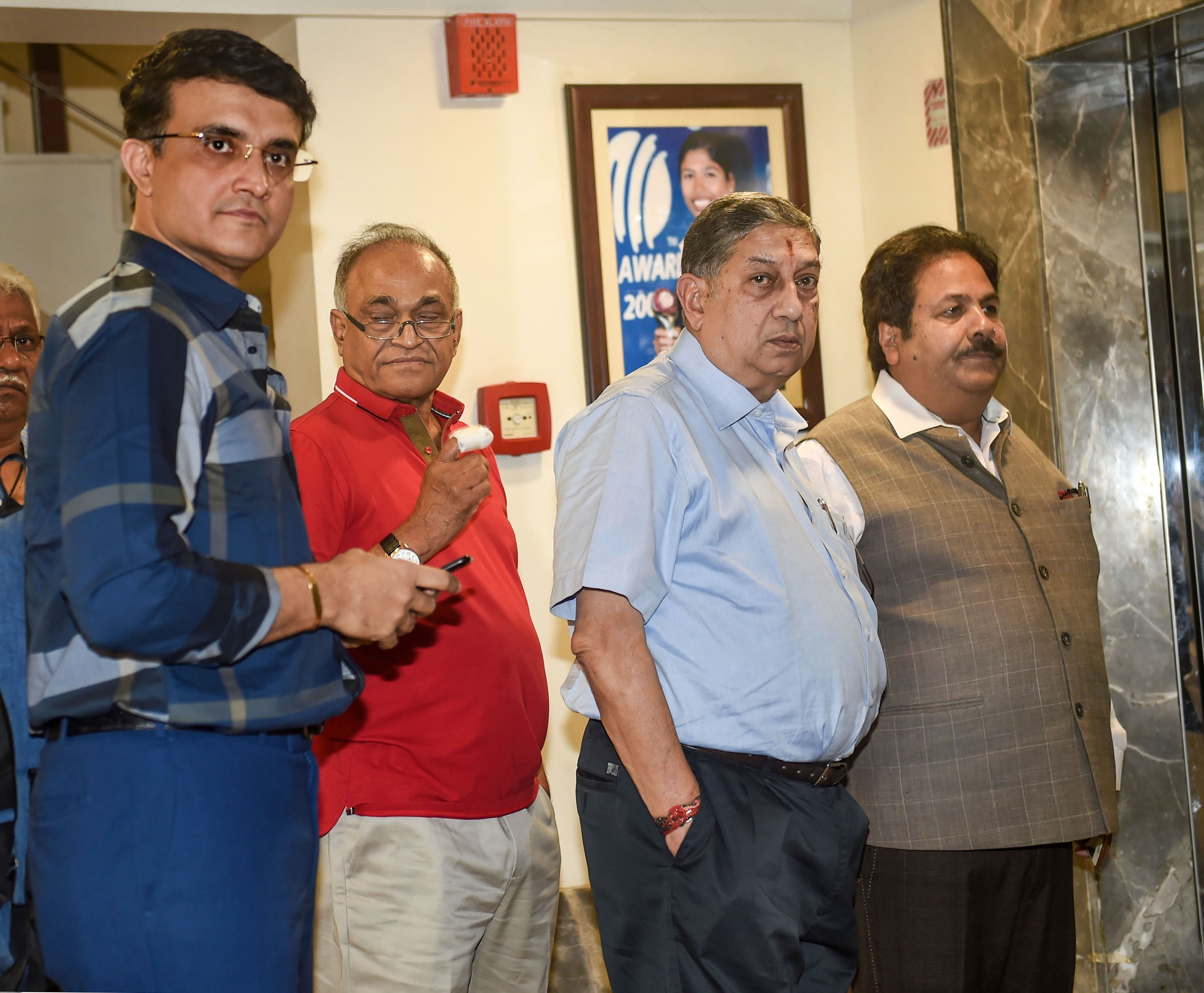 Former cricketer Saurav Ganguly arrives at the BCCI headquarters, along with former BCCI chief N. Srinivasan, to file his nomination for the board president's post, in Mumbai, Monday, October 14, 2019.