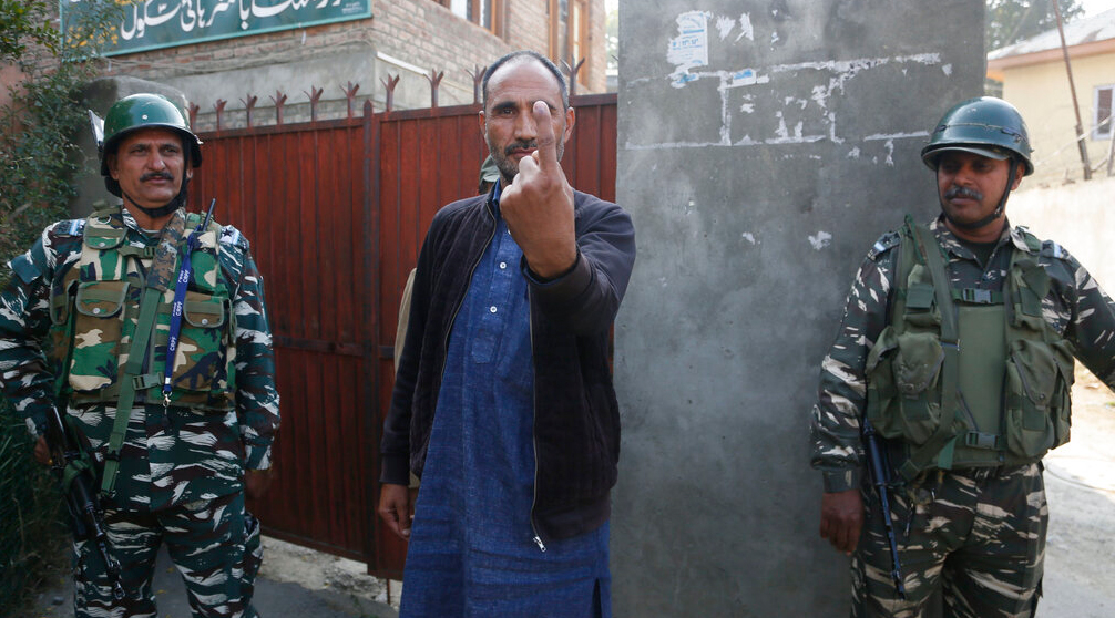 Village council candidate Ghulam Hassan Rather shows the ink mark on his finger after casting his vote, near a polling station on the outskirts of Srinagar on Thursday, October 24, 2019
