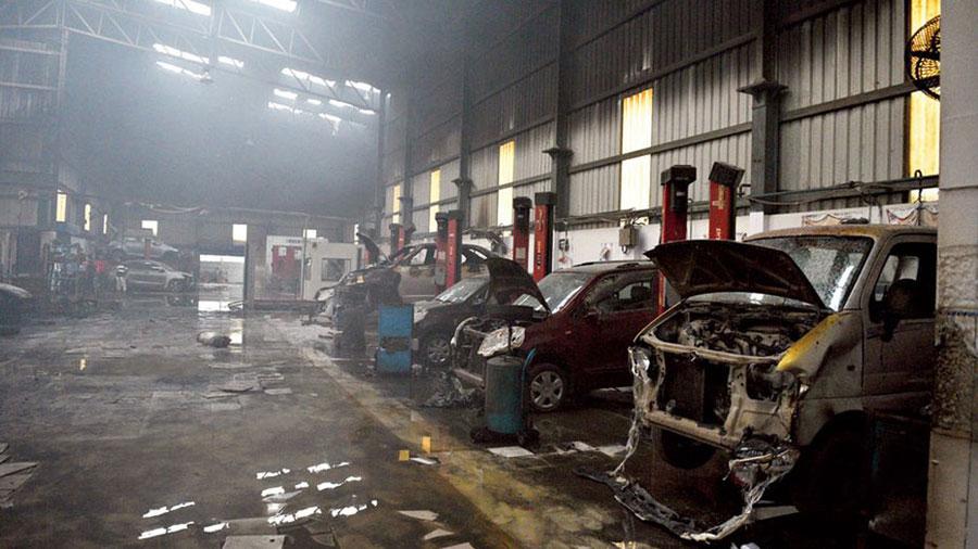 The fire-ravaged Maruti Suzuki service station off the EM Bypass