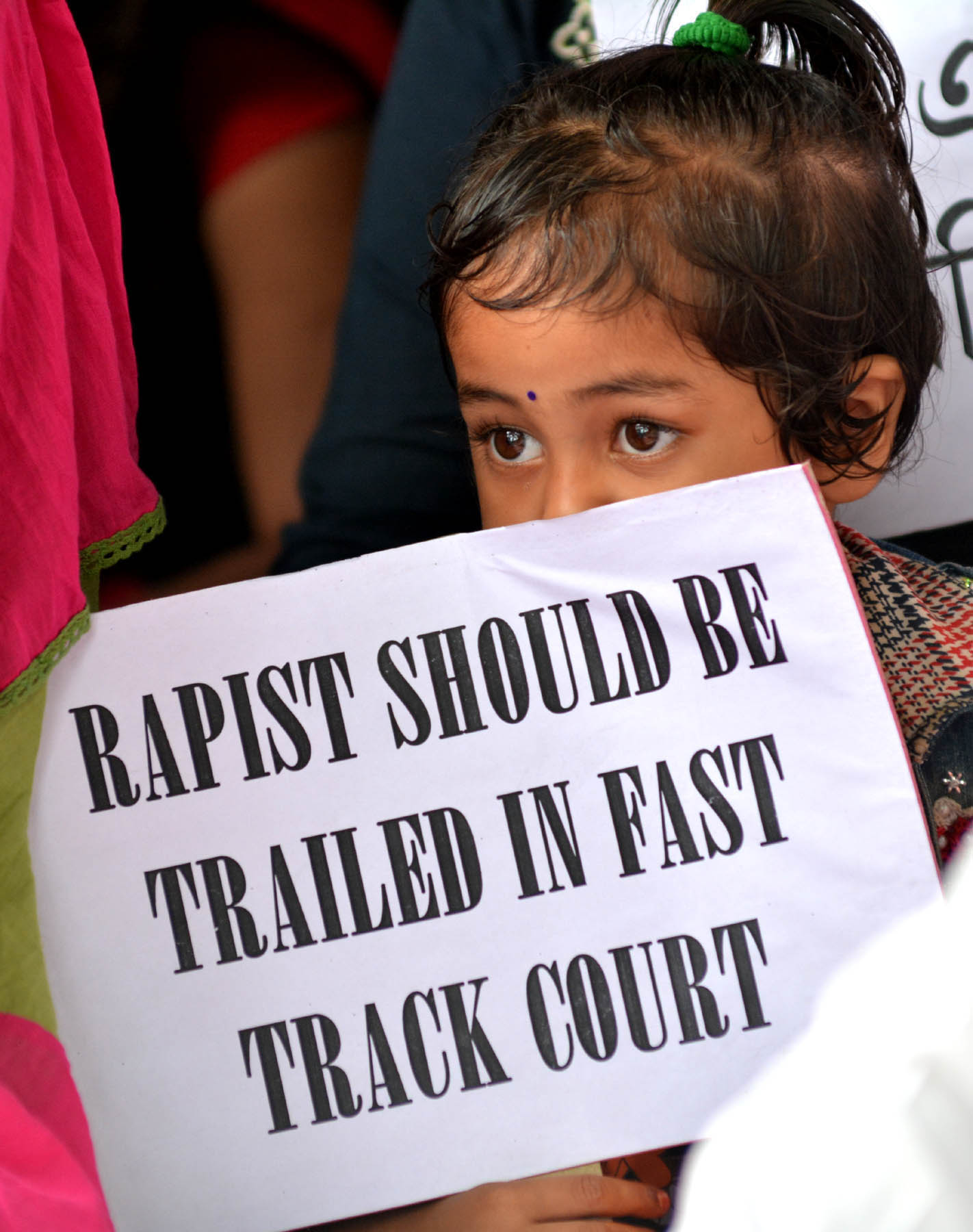 A young girl takes part in a protest against the rape of the eight-year-old girl in Kathua.
