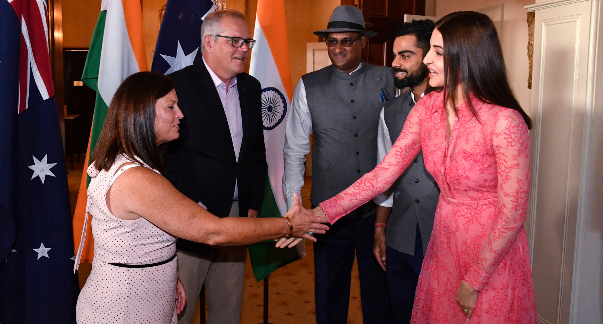 Australia's Prime Minister Scott Morrison, second left, and his wife, Jenny, right, meet India's cricket captain Virat Kohli, second right, and his wife, Anushka Sharma, right, during a reception for Australia's and India's cricket teams at Kirribilli House in Sydney on Tuesday, Jan. 1, 2019.