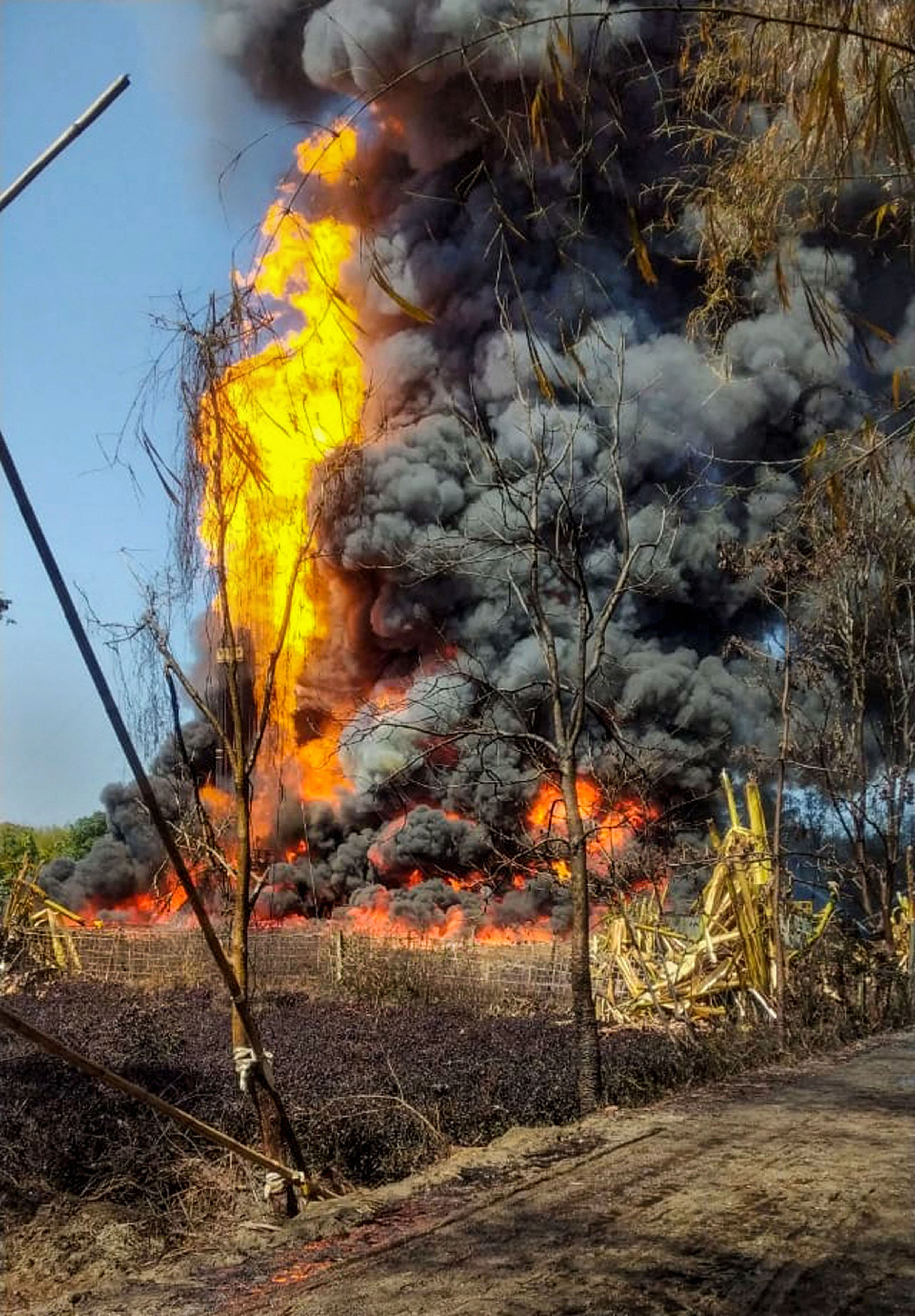 Smoke billows from a fire at Baghjan oil field, a week after a blowout, in Tinsukia district, Tuesday, June 9, 2020.