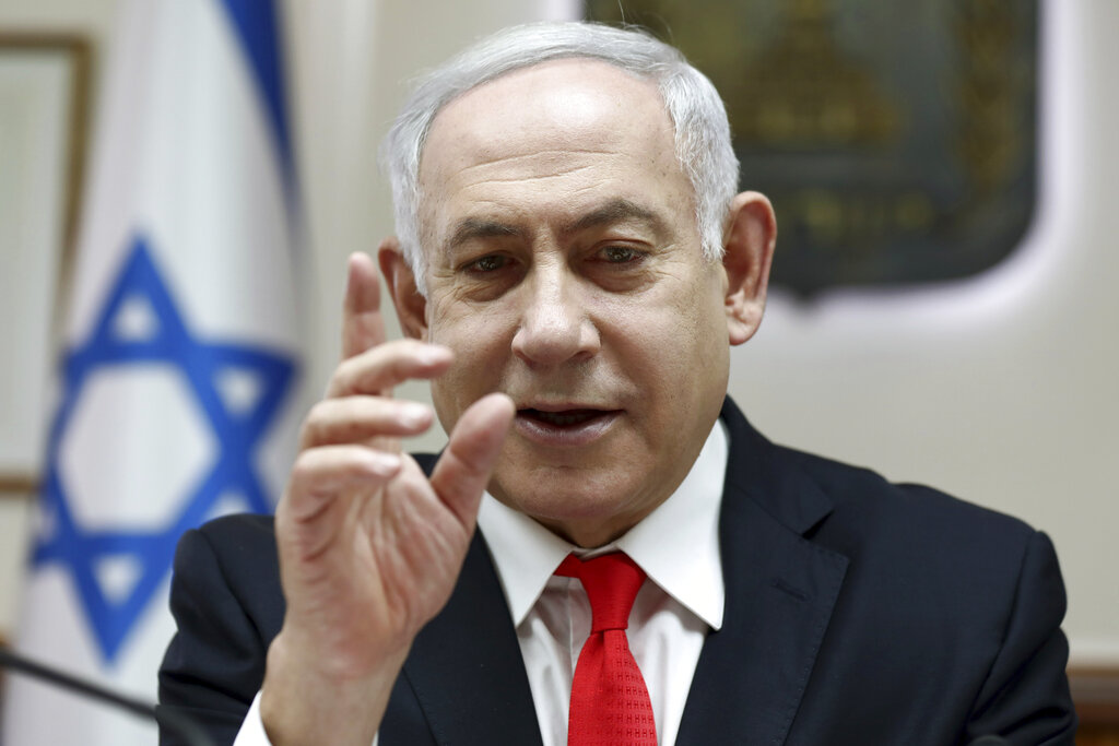 Israeli Prime Minister Benjamin Netanyahu reacts during the weekly cabinet meeting, at his office in Jerusalem, Sunday, Dec. 15, 2019.