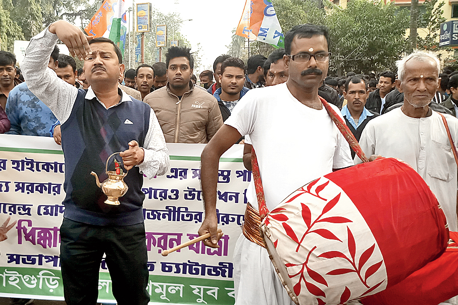 Trinamul workers take out a march against Prime Minister Narendra Modi's visit in Jalpaiguri on Friday.