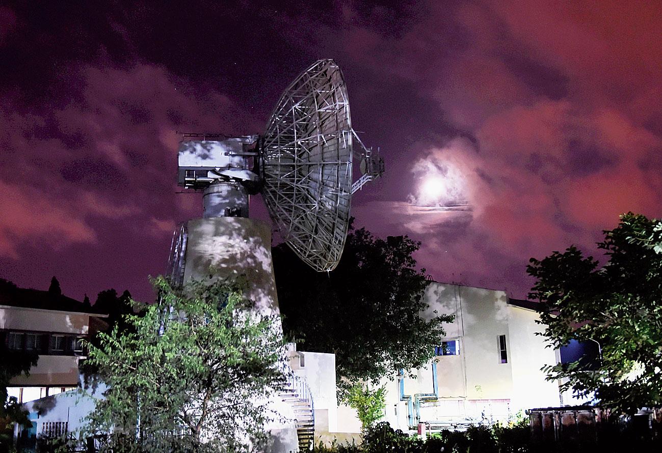 A dish antenna tracks the moon at Isro on Friday.