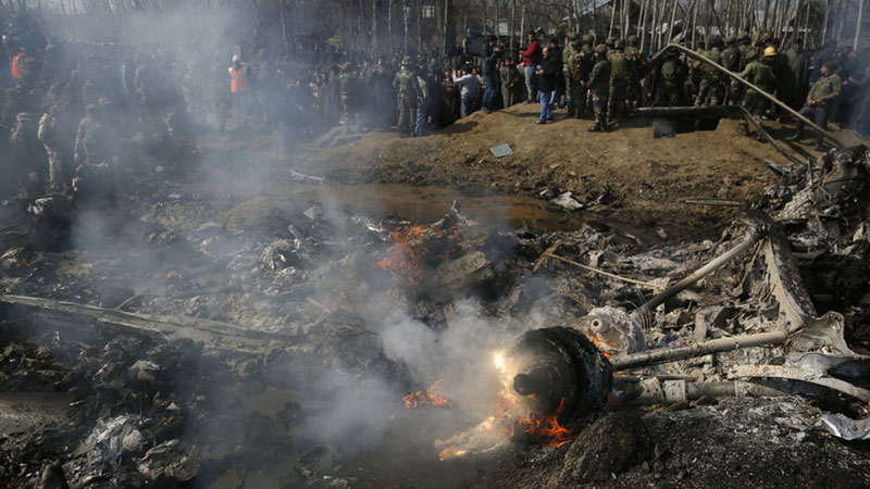 Villagers and soldiers gather near the wreckage of the IAF chopper that crashed in Budgam on the outskirts of Srinagar on February 27
