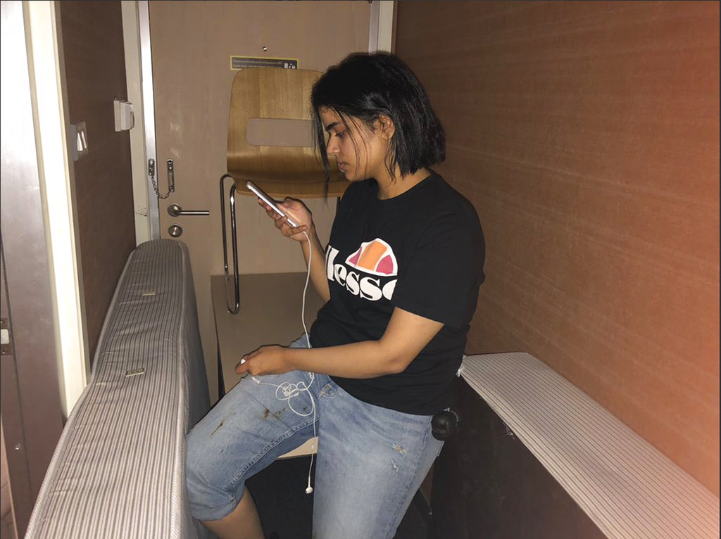 Rahaf Mohammed Alqunan sits barricaded in a hotel room at an international airport in Bangkok on Monday.