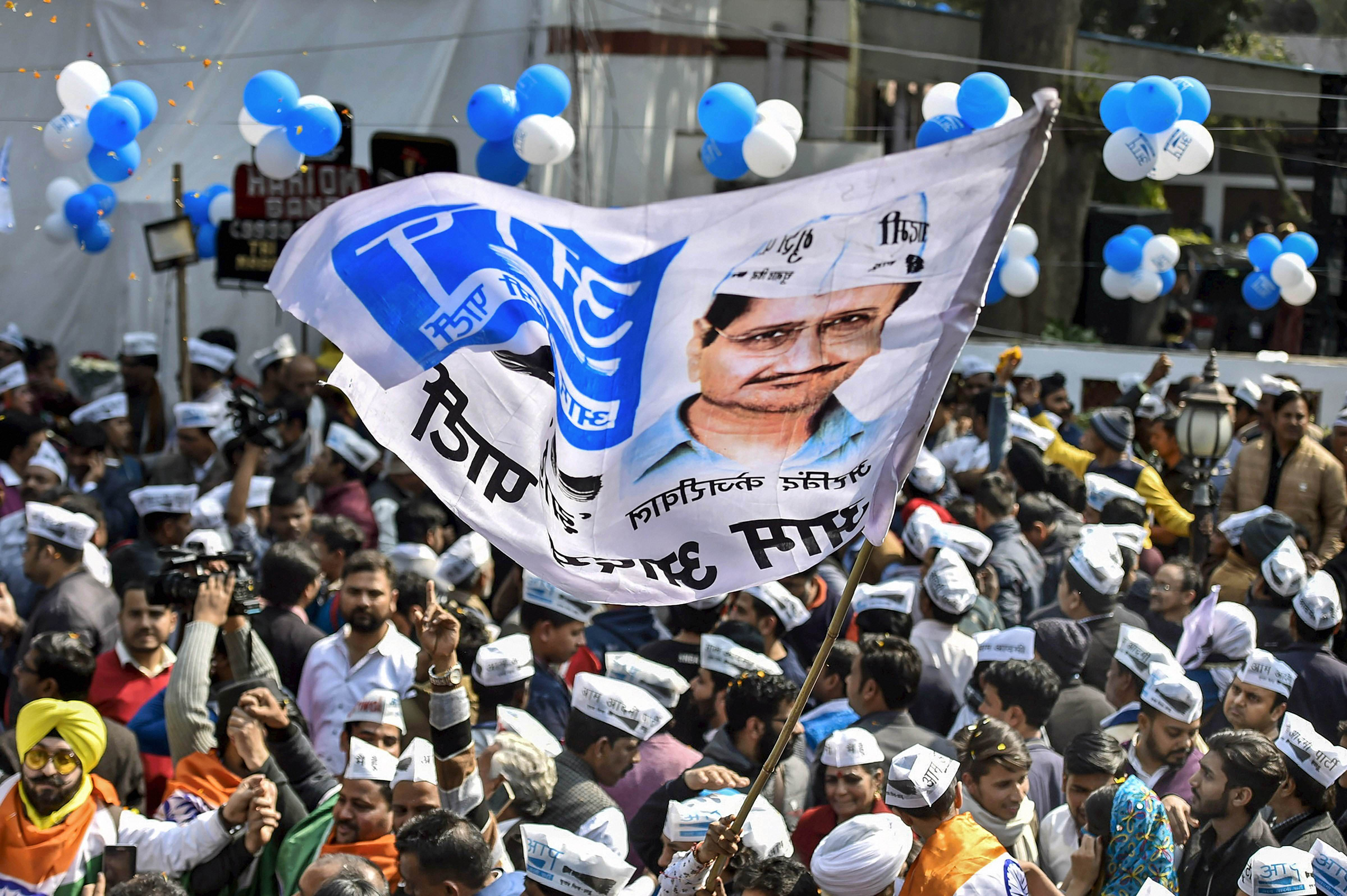 Aam Aadmi Party workers celebrate ahead of the final results, as early trends show party's victory in the Delhi Assembly polls, at party headquarters in New Delhi, Tuesday, Feb. 11, 2020.