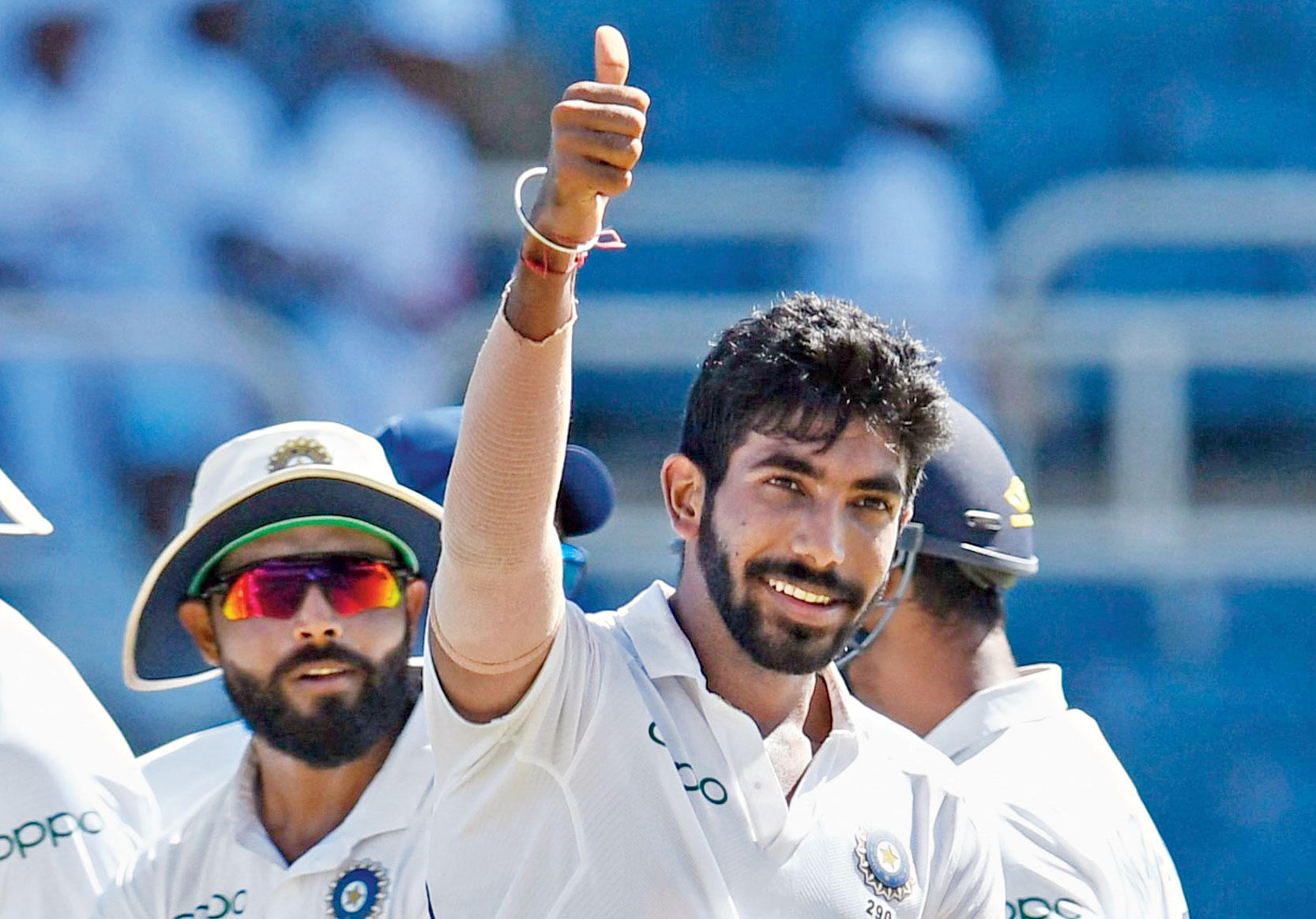 Jasprit Bumrah celebrates with teammates after taking the wicket of Roston Chase at Sabina Park in Kingston on Saturday.