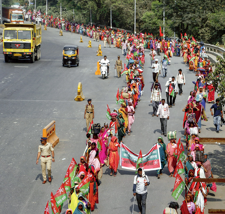 Farmers and tribals march in Thane on Wednesday.