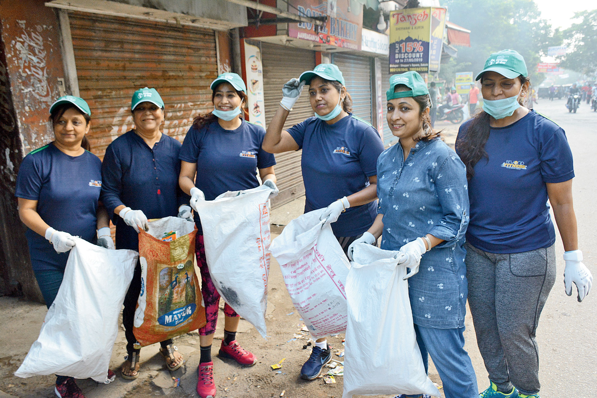 Plogging participants pick up plastic waste in Sakchi, Jamshedpur, on Wednesday.