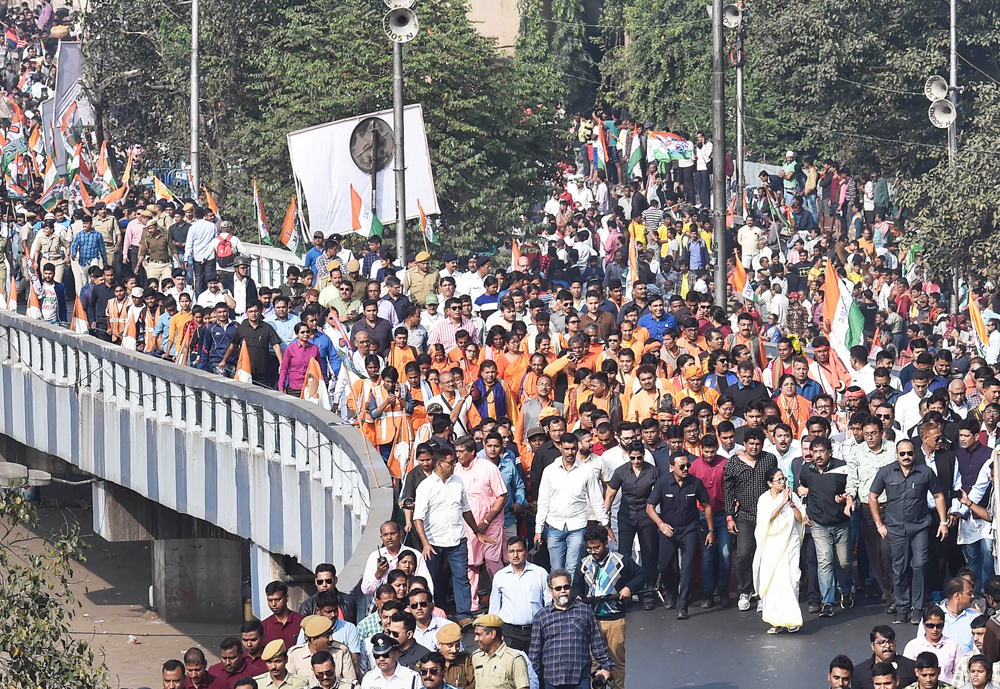 West Bengal Chief Minister Mamata Banerjee leads a protests rally of her party workers against the NRC and the Citizenship Amendment Act, in Calcutta, Wednesday, December 18, 2019.