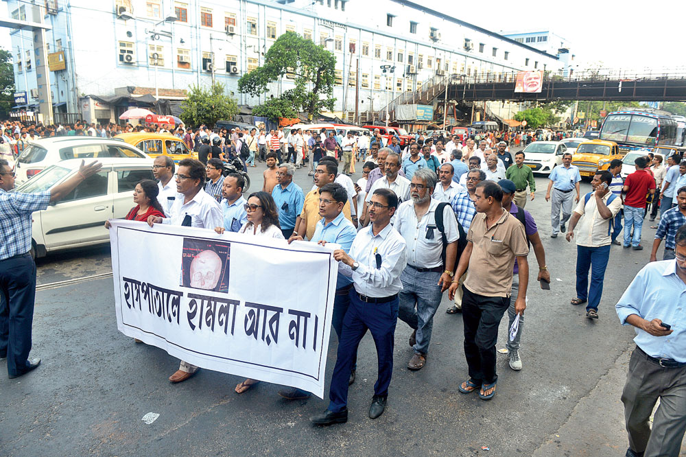 A protest rally by senior doctors on APC Road outside NRS Medical College and Hospital