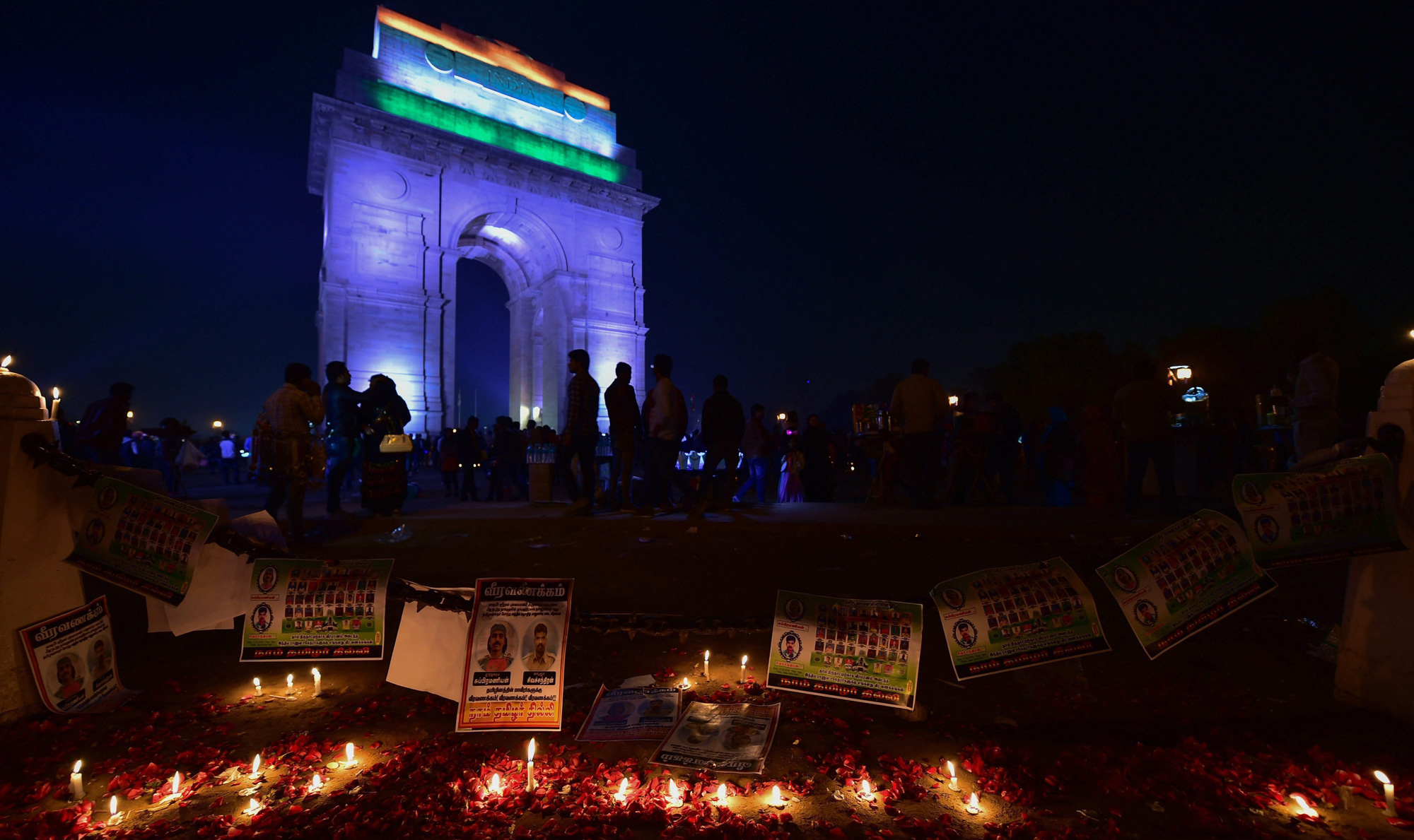 People participate in a candle light vigil to offer tributes to the martyred CRPF jawans of Pulwama terror attack, at India Gate in New Delhi on Sunday, February 17, 2019.