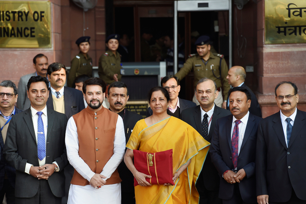 Finance minister Nirmala Sitharaman, holding a folder containing the Union Budget documents, poses for photographers along with her deputy Anurag Thakur, chief economic adviser Krishnamurthy Subramanian and a team of officials.