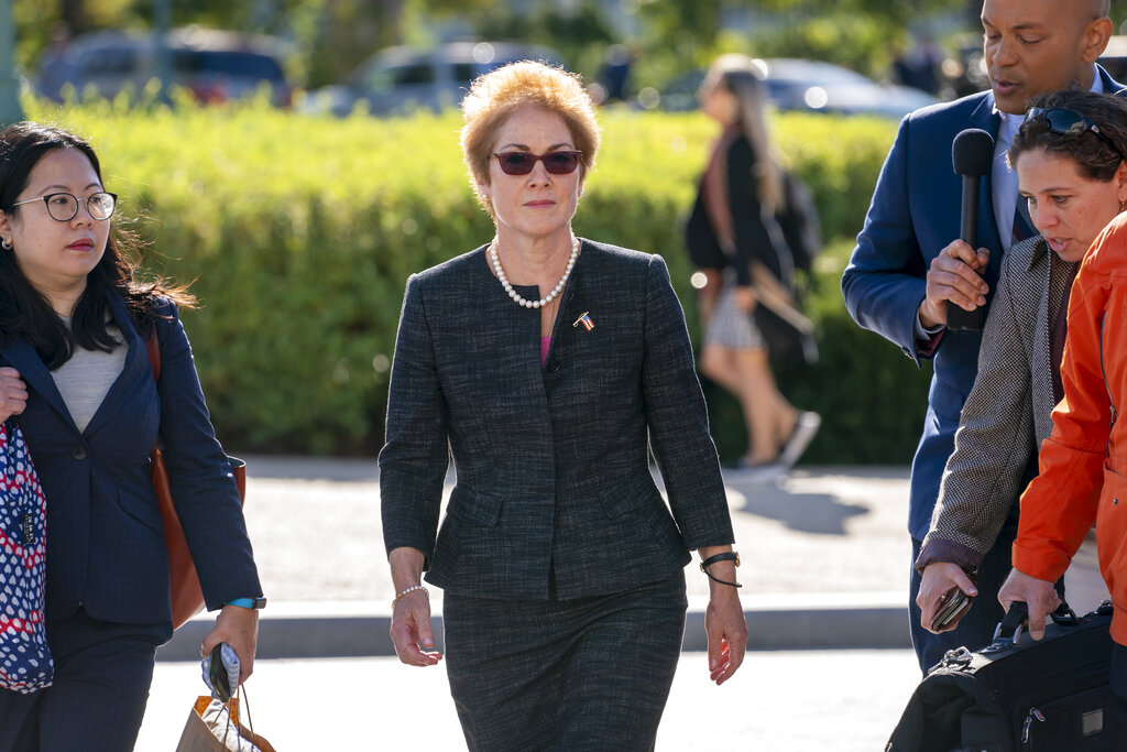 In this October. 11, 2019, file photo, former US ambassador to Ukraine Marie Yovanovitch, center, arrives on Capitol Hill in Washington, to testify before congressional lawmakers as part of the House impeachment inquiry into President Donald Trump.