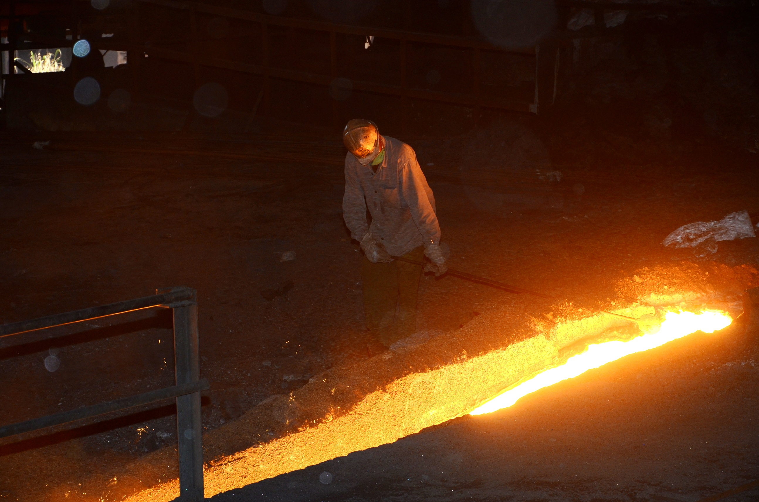 A worker near a BSL blast furnace