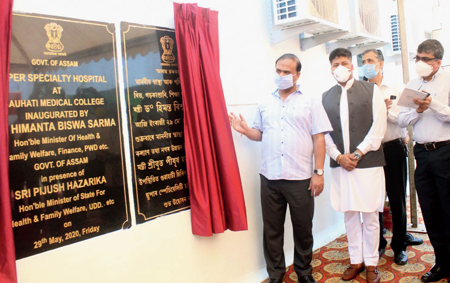 Assam health minister Himanta Biswa Sarma unveils the plaque for the super-speciality Covid-19 hospital in Guwahati on Friday.