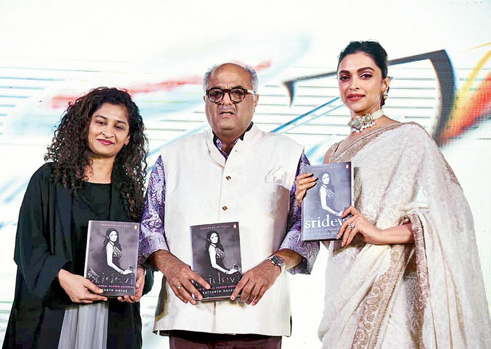 Filmmaker Gauri Shinde, Boney Kapoor and Deepika Padukone at the launch of the book in Delhi
