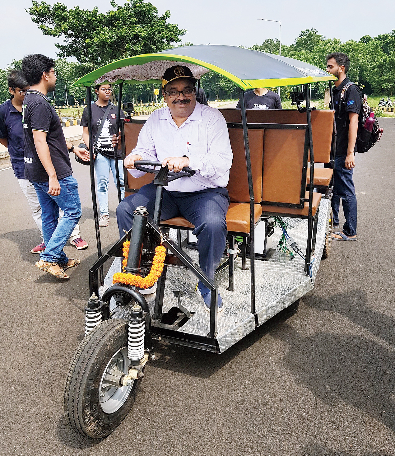 Partha Pratim Chakraborty, former director of IIT Kharagpur, on the e-rickshaw on the campus.