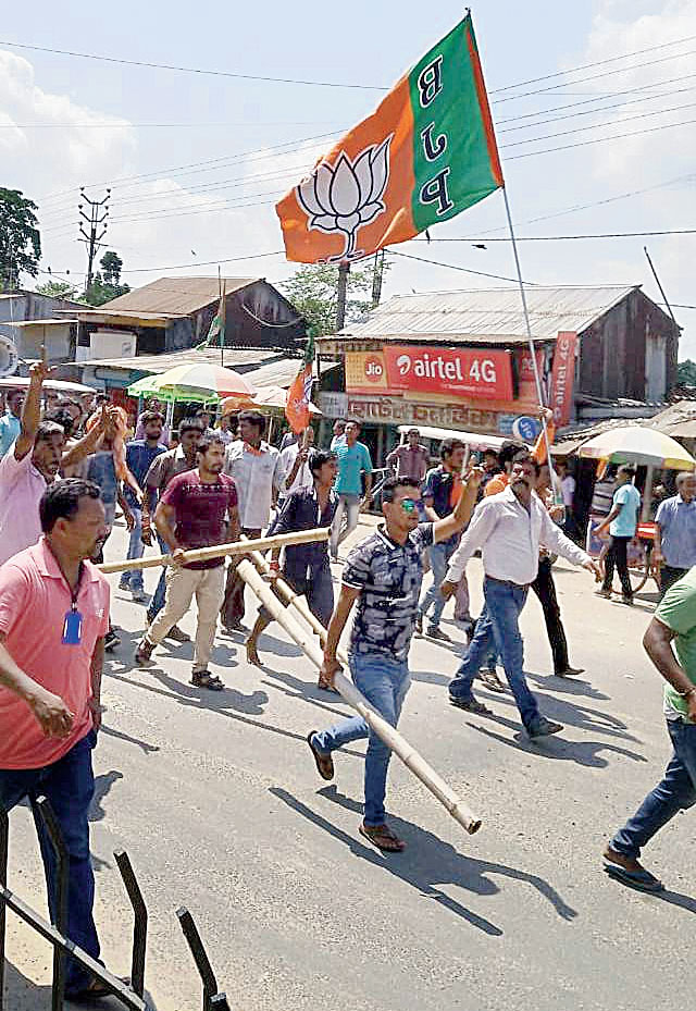 BJP supporters wielding party flags and sticks in Gangarampur.